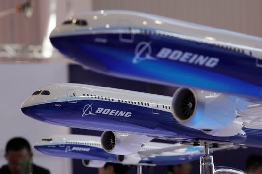 FILE- In this Nov. 6, 2018, file photo, models of Boeing passenger airliners are displayed during the Airshow China in Zhuhai city, south China's Guangdong province.