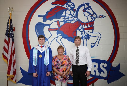 Lakewood High School salutatorian, Grant Davis, stands for a portrait with his grandmother, Betsy Ables Davis, and his father, Donald Davis, before the Lakewood graduation ceremony on Sunday. Grant is a third generation salutatorian at Lakewood, following his grandmother and father.