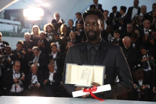 Director Ladj Ly, with his jury prize for the film 'Les Miserables during a photo call following the awards ceremony at the 72nd international film festival, Cannes, southern France, Saturday, May 25, 2019.