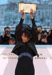 Director Mati Diop, winner of the grand prix Palme d'Or award for the film 'Atlantique' poses for photographers during a photo call following the awards ceremony at the 72nd international film festival, Cannes, southern France, Saturday, May 25, 2019.