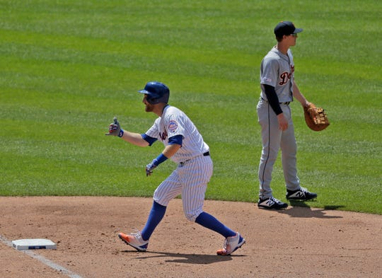 New York Mets' Todd Frazier, left, reacts after hitting an RBI-bunt single during the fourth inning of a  game against the Detroit Tigers at Citi Field, Sunday, May 26, 2019, in New York.