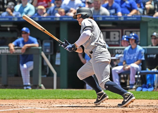 May 26, 2019; Kansas City, MO, USA; New York Yankees right fielder Clint Frazier (77) hit an RBI single during the second inning against the Kansas City Royals at Kauffman Stadium.