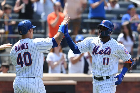 May 26, 2019; New York City, NY, USA; New York Mets shortstop Adeiny Hechavarria (11) high-fives Wilson Ramos (40) after hitting a home run during the fourth inning of a game against the Detroit Tigers at Citi Field.