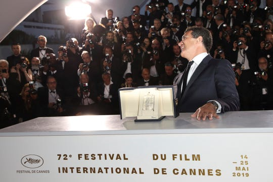 Actor Antonio Banderas poses with the best actor Palme d'Or award for the film 'Pain and Glory' during a photo call following the awards ceremony at the 72nd international film festival, Cannes, southern France, Saturday, May 25, 2019.