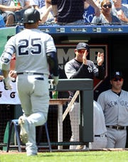 KANSAS CITY, MISSOURI - MAY 26:  Manager Aaron Boone #17 of the New York Yankees claps as Gleyber Torres #25 heads bcak to the dugout after hitting a three-run home run during the 6th inning of the game against the Kansas City Royals at Kauffman Stadium on May 26, 2019 in Kansas City, Missouri.