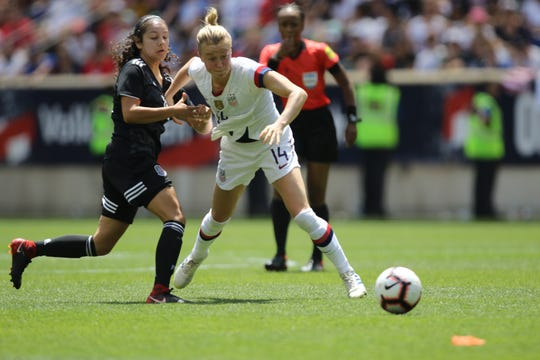 Alexia Delgado, of Mexico and Emily Sonnett, of the U.S. battle for the ball int he second half.  The U.S. went on to beat Mexico, 3-0.  Sunday, May 26, 2019