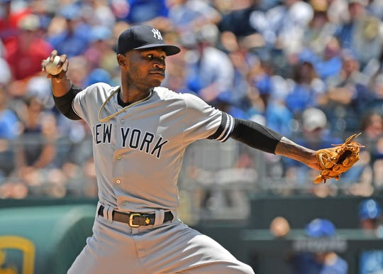 May 26, 2019; Kansas City, MO, USA; New York Yankees starting pitcher Domingo German (55) throws the ball during the first inning against the Kansas City Royals at Kauffman Stadium.