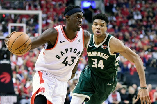 Toronto Raptors forward Pascal Siakam (43) moves up court as Milwaukee Bucks forward Giannis Antetokounmpo (34) defends during the second half of Game 4 of the NBA basketball playoffs Eastern Conference finals, Tuesday, May 21, 2019 in Toronto. (Frank Gunn/The Canadian Press via AP)