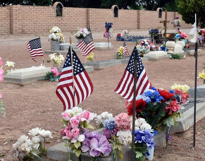 American flags dot the grave sites at St. Joseph's Cemetery on Sunday, May 26, 2019. The flags were placed on the grave sites of veterans.