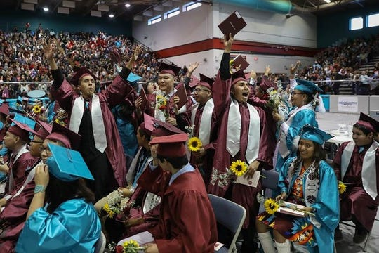 Shiprock High School's Class of 2019 acknowledge and thank their parents during the commencement exercises on Friday at the Chieftain Pit.