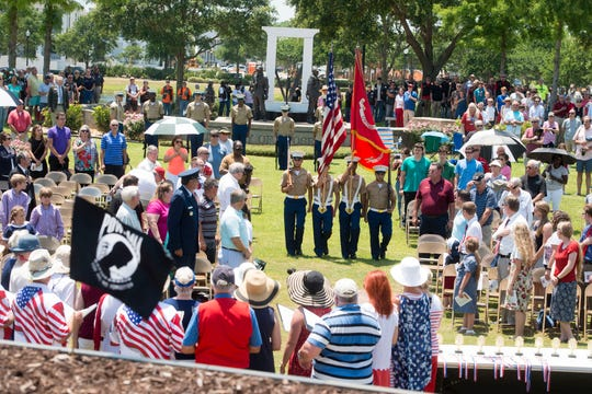 Hundreds of people honored the fallen during a Memorial Day observance Sunday at Veterans Memorial Park in Pensacola. Find more photos at pnj.com.
