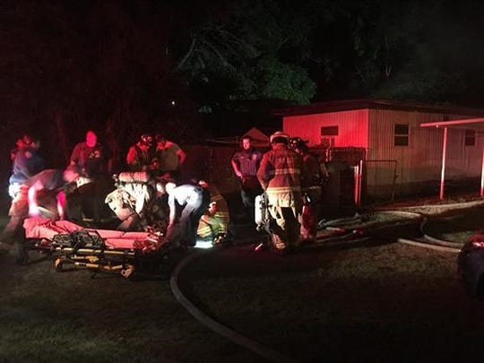 Escambia County Fire Rescue firefighters and EMS crews respond Friday to a mobile home fire in the 3000 block of Miller Street.
