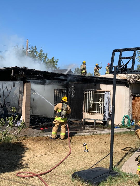 Phoenix firefighters combat a blaze at a duplex on May 25, 2019.