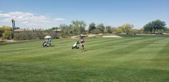 Sadie Englemann prepares to take a shot on the seventh hole with Cindy Kou (left) on Sunday at the Thunderbird International Junior.