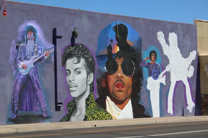 A mural of Prince is being painted on 15th Avenue and Roosevelt Street, near Rodriguez Boxing Club, May 26, 2019.