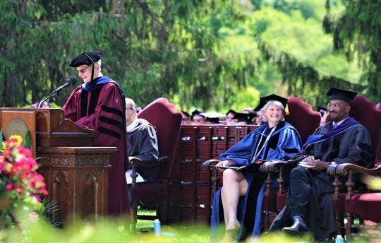 Jonathan Chenette, dean of the faculty, (left) speaks to Vassar College's class of 2019 on Sunday, May 26, 2019. President Elizabeth Bradley and Van Jones are seen to his right.