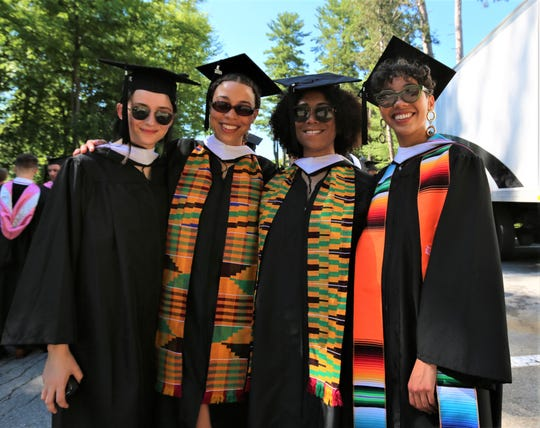 Mollie Kather, Rachael Hall, Dana Chang and Nicole Gonzalez, from left to right, pose for a photo together as they wait for their graduation ceremony at Vassar College on Sunday, May 26, 2019.
