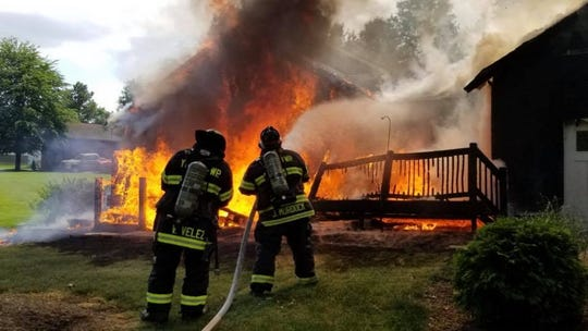 Firefighters battle a fire that broke out at a York Township home on Saturday.