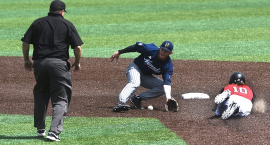 Nevada's Keaton Smith looks to put a tag on UNLV's Bryson Stott during Saturday's Mountain West tournament game at Peccole Park.