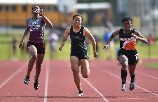 Edison's Djeynaba Thiam, left, wins the 200-meter dash over Rush-Henrietta's Jaelyn Davis, center, and Churchville Chili's Taylor Allen during the Section V Class AA Track & Field Championships at Avon High School, Saturday, May 25, 2019.