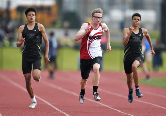 Penfield's Andy Frank, center, wins the 200-meter dash with a time of 21.56 over Rush-Henrietta's Jason Boykins, left, and Miles Boykins during the Section V Class AA Track & Field Championships at Avon High School, Saturday, May 25, 2019.