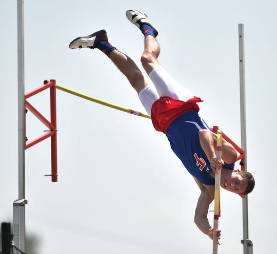 Fairport's Ryan Harman wins the pole vault with a height of 14 feet during the Section V Class AA Track & Field Championships at Avon High School on Saturday, May 25, 2019.