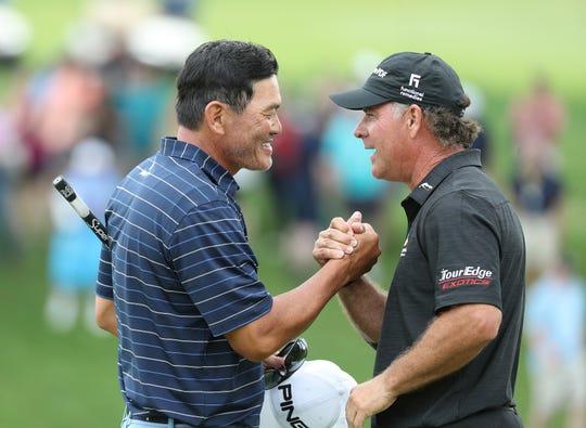 Ken Tanigawa is congratulated by Scott McCarron after winning the Senior PGA Championship.