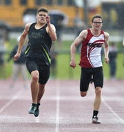 Rush-Henrietta's Ben Hulbert, left, edges Penfield's Andy Frank to win the 400-meter dash with a time of 48.58 during the Section V Class AA Track & Field Championships at Avon High School, Saturday, May 25, 2019.