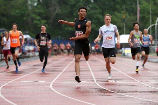 Dalllas' Malaki Connella finishes first in the 6A boys 400 meter dash at the 2019 OSAA Track and Field State Championships in Gresham on May 25, 2019.