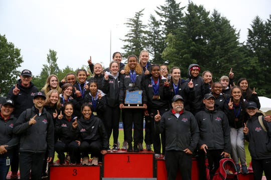 North Salem girls celebrate their first place 5A state title at the 2019 OSAA Track and Field State Championships in Gresham on May 25, 2019.