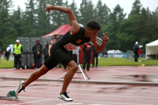 Dalllas' Malaki Connella takes off in the 6A boys 400 meter dash at the 2019 OSAA Track and Field State Championships in Gresham on May 25, 2019.