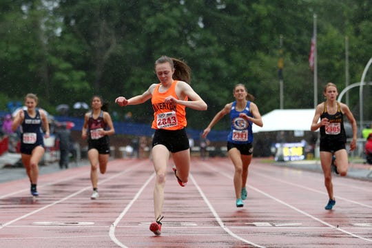 Silverton's Justice McBride crosses the finish line first in the 5A girls 400 meter dash at the 2019 OSAA Track and Field State Championships in Gresham on May 25, 2019.