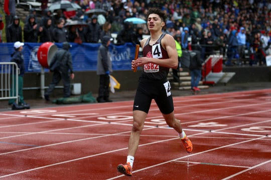 North Salem's David Rojas crosses the finish line in the 5A boys 4x400 meter relay at the 2019 OSAA Track and Field State Championships in Gresham on May 25, 2019.