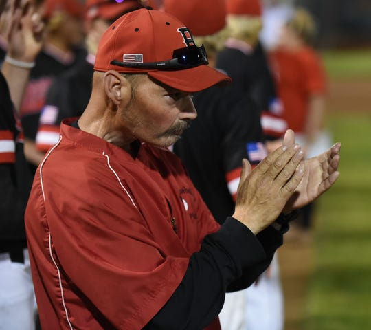 James M. Bennett head coach Jay Fenoglietto claps after his team defeated C. Milton Wright in the 3A state championship on Saturday, May 25, 2019.