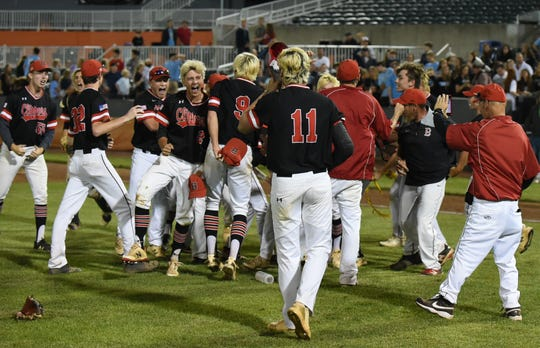 The James M. Bennett Clippers celebrate after winning the 3A state championship against C. Milton Wright on Saturday, May 25, 2019.