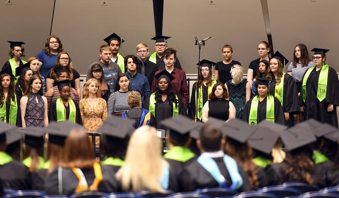 The New Technology High School choir performs at graduation Sunday morning, May 26, at the Sioux Falls Arena.