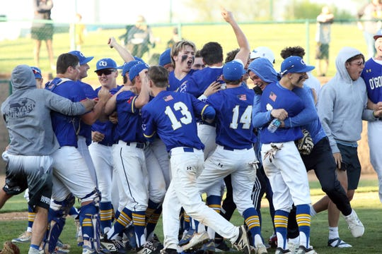 Members of the O'Gorman baseball team celebrate their championship win over Mitchell 11-4 on Saturday in Sioux Falls.