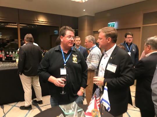 Florida Rep. Randy Fine talks with  FPL President Eric Silagy during a meet-and-greet session at the Hilton Tel Aviv after the Florida delegation touched down for a four-day trade mission to Israel.