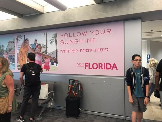 A Visit Florida ad was the first thing to greet the Florida delegation to Israel as they disembarked in Tel Aviv after a 12 hour flight.