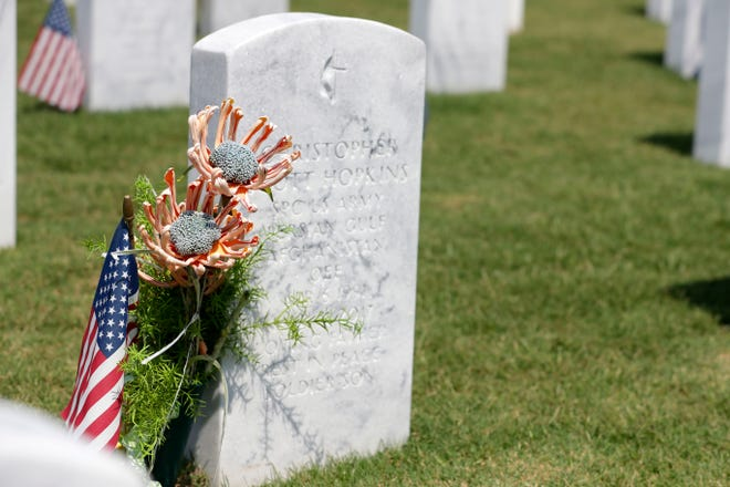 Families can still places flags at gravesites at the Tallahassee National Cemetery for Memorial Day, but the there will be no large events this year.