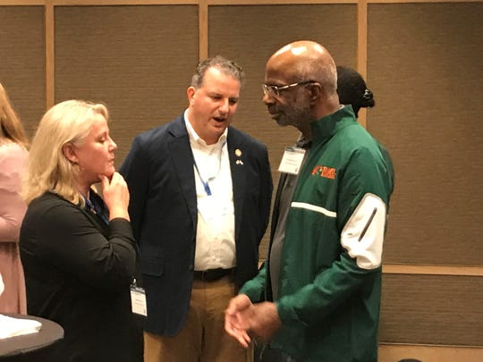 Florida A&M president Larry Robinson and Chief Financial Officer Jimmy Patronis mingle during a meet-and-greet session at the Hilton Tel Aviv after the Florida delegation touched down for a four-day trade mission to Israel.