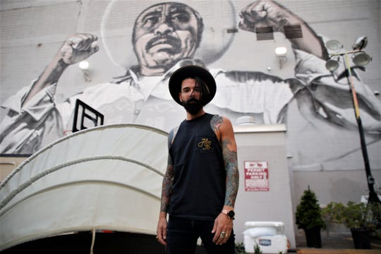 Chris Carrabba of Dashboard Confessional stands in front of a mural at Neon Desert Music Festival on Saturday, May 25, 2019, in Downtown El Paso.