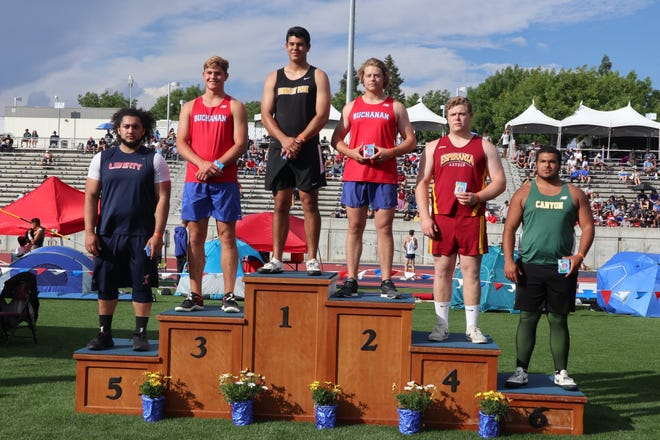 Newbury Park senior Gino Cruz stands atop the podium after winning the state championship in the boys discus on Saturday at Buchanan High in Clovis.