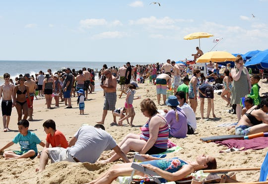 Beachgoers enjoy the sun-soaked weather at Rehoboth Beach during Memorial Day weekend Sunday, May 26.