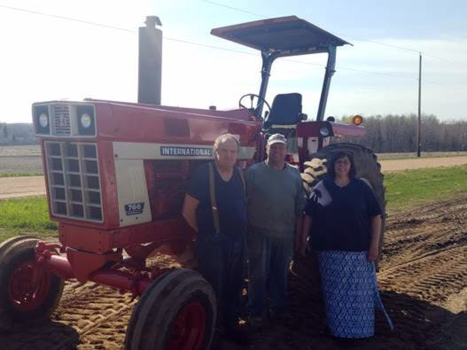 Glen Wendt (middle), a dairy farmer from Merrill, won the drawing for a free Rollover Protection Structure (ROPS) at 2018 Wisconsin Farm Technology Days. He retrofit this International 766. With Glen is his wife, Brenda, and brother, Jack.