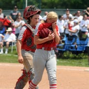 Catcher Madie Walker consoles pitcher Sydney Campolo following Sheridan's 13-3 loss to Plain City Jonathan Alder on Saturday in Pickerington.