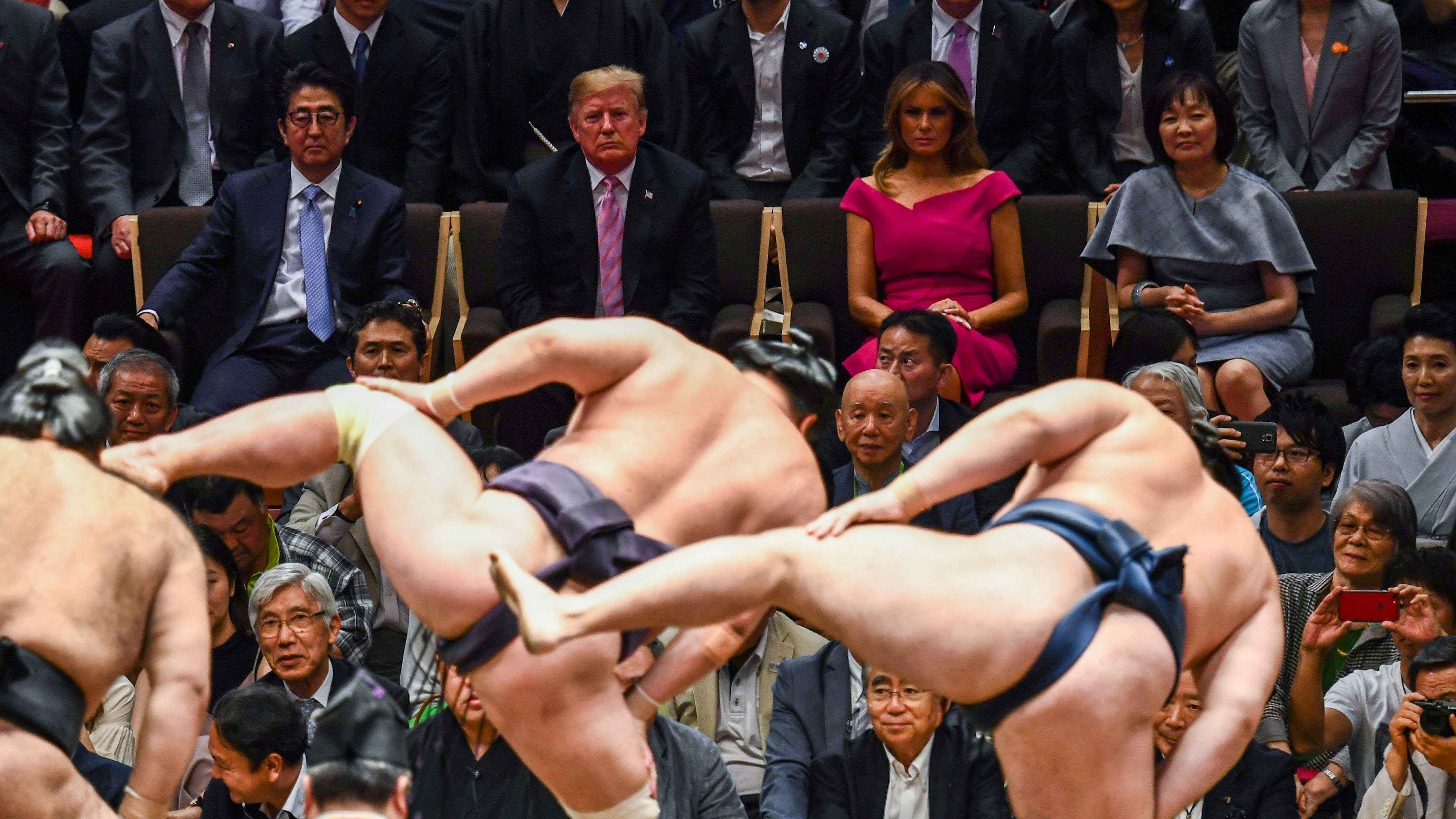 U.S. President Donald Trump and First Lady Melania Trump are accompanied by Japan's Prime Minister Shinzo Abe and his wife Akie Abe (center row) as they watch a sumo demonstration during the Summer Grand Sumo Tournament in Tokyo on May 26, 2019.