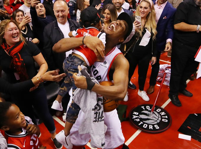 May 25: Raptors guard Kyle Lowry celebrates with his son after finishing off the Bucks to reach the NBA Finals.