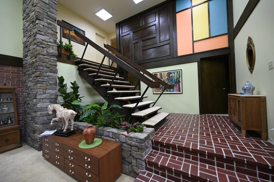"Hosts of HGTV series rebuilt and remodeled the interior of the famed ""Brady Bunch"" home in Los Angeles, including adding a second floor to accommodate the show's memorable staircase."