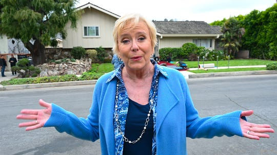 "Eve Plumb, who played Jan on ""The Brady Bunch,"" stands in front of the home that served as the TV show's exterior on the popular family sitcom. The rooms inside were redesigned to match ""Brady Bunch"" sets for HGTV's ""A Very Brady Renovation."""